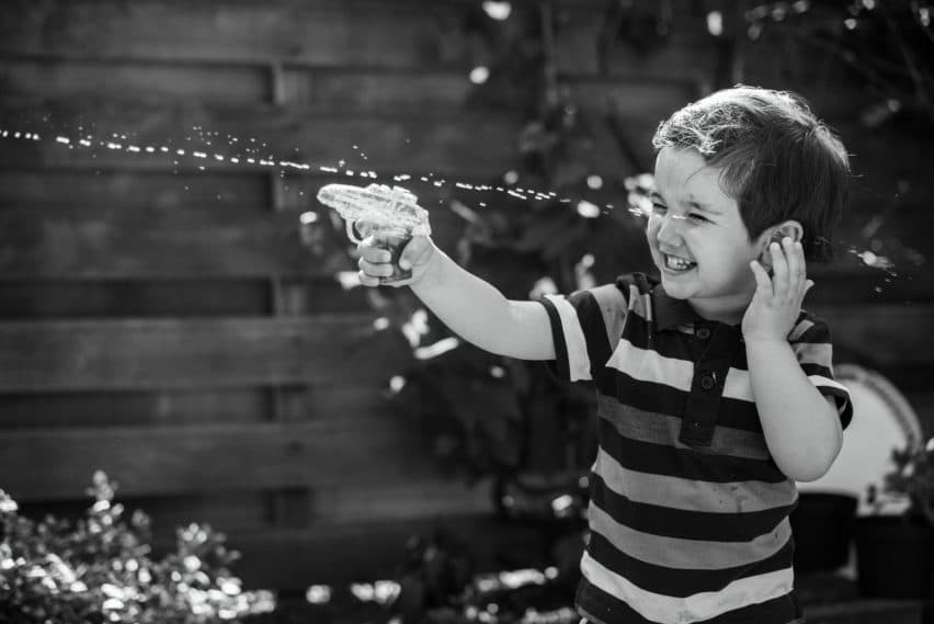 little boy with pater pistol