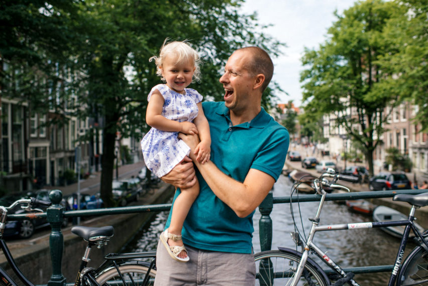Father holding his daughter in Amsterdam