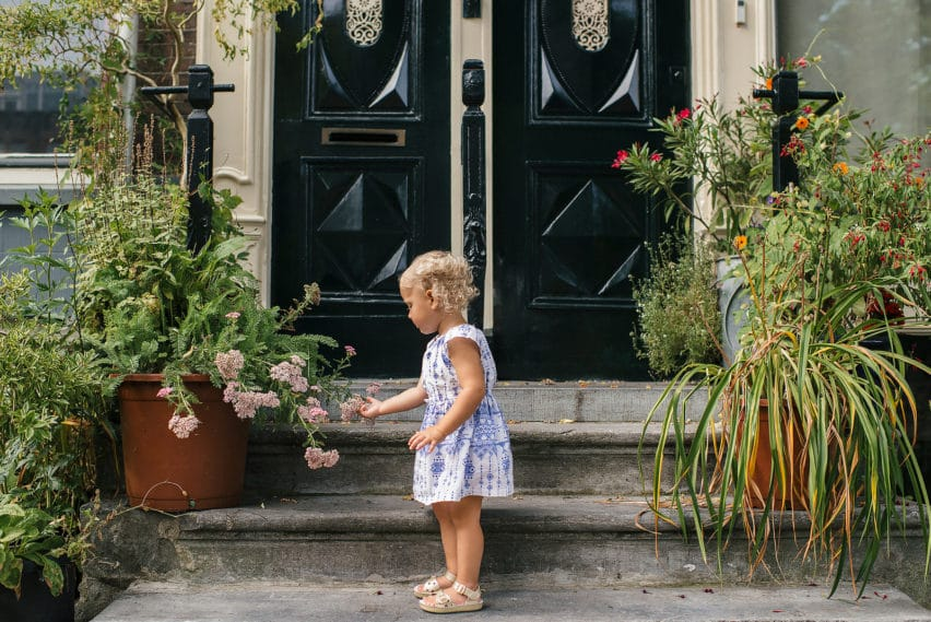 Little girl looking at plants in Amsterdam
