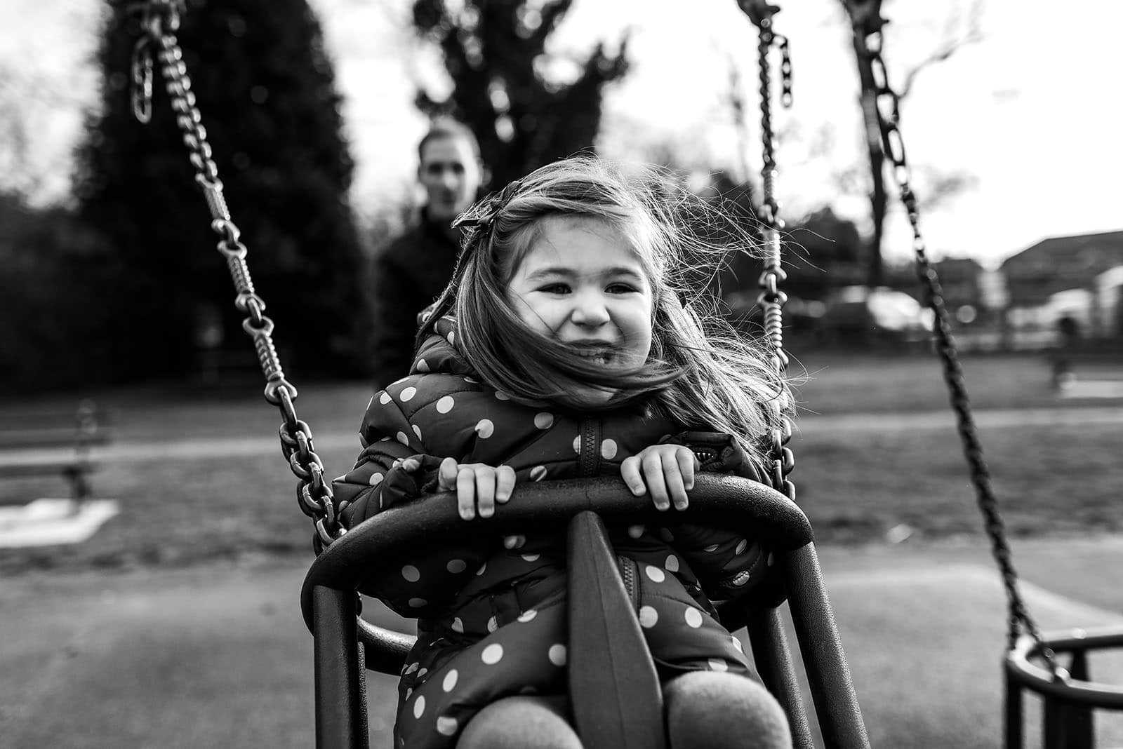 little girl on swing at the park