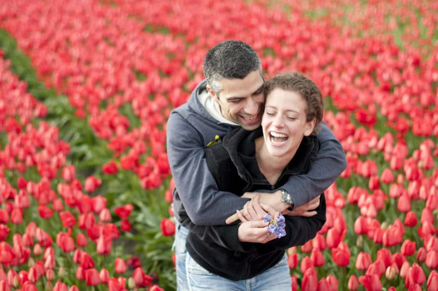 couple laughing in tulip field in Holland