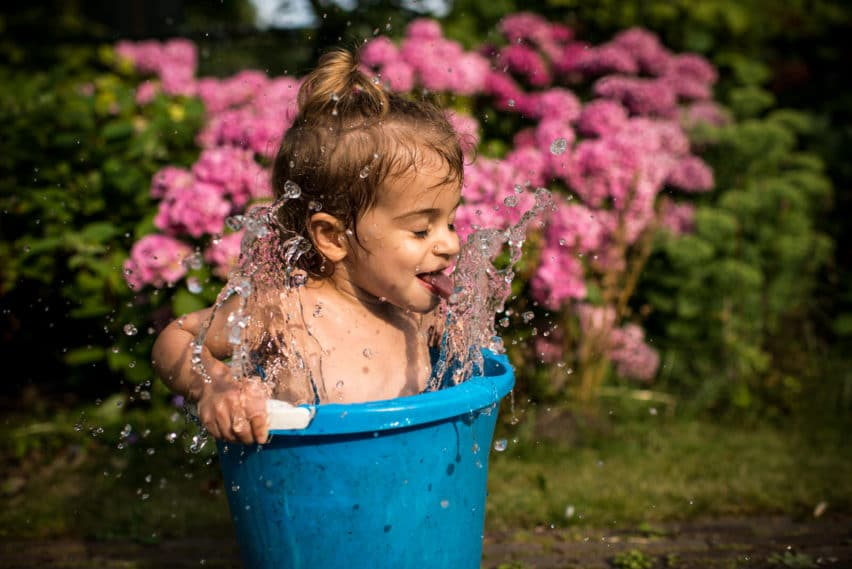 Creative Family Photography kid splashing in bucket
