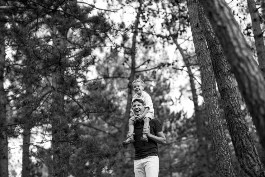 Little boy on fathers shoulders