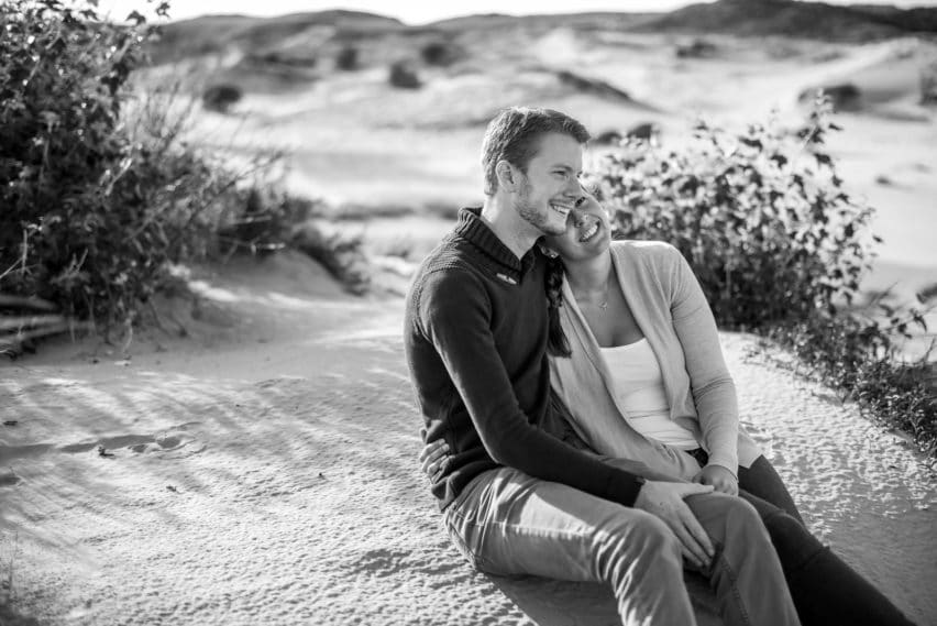 couple sat in sand dunes