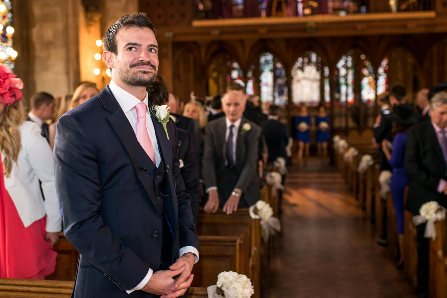 groom waiting at the alter of St Etheldredas church