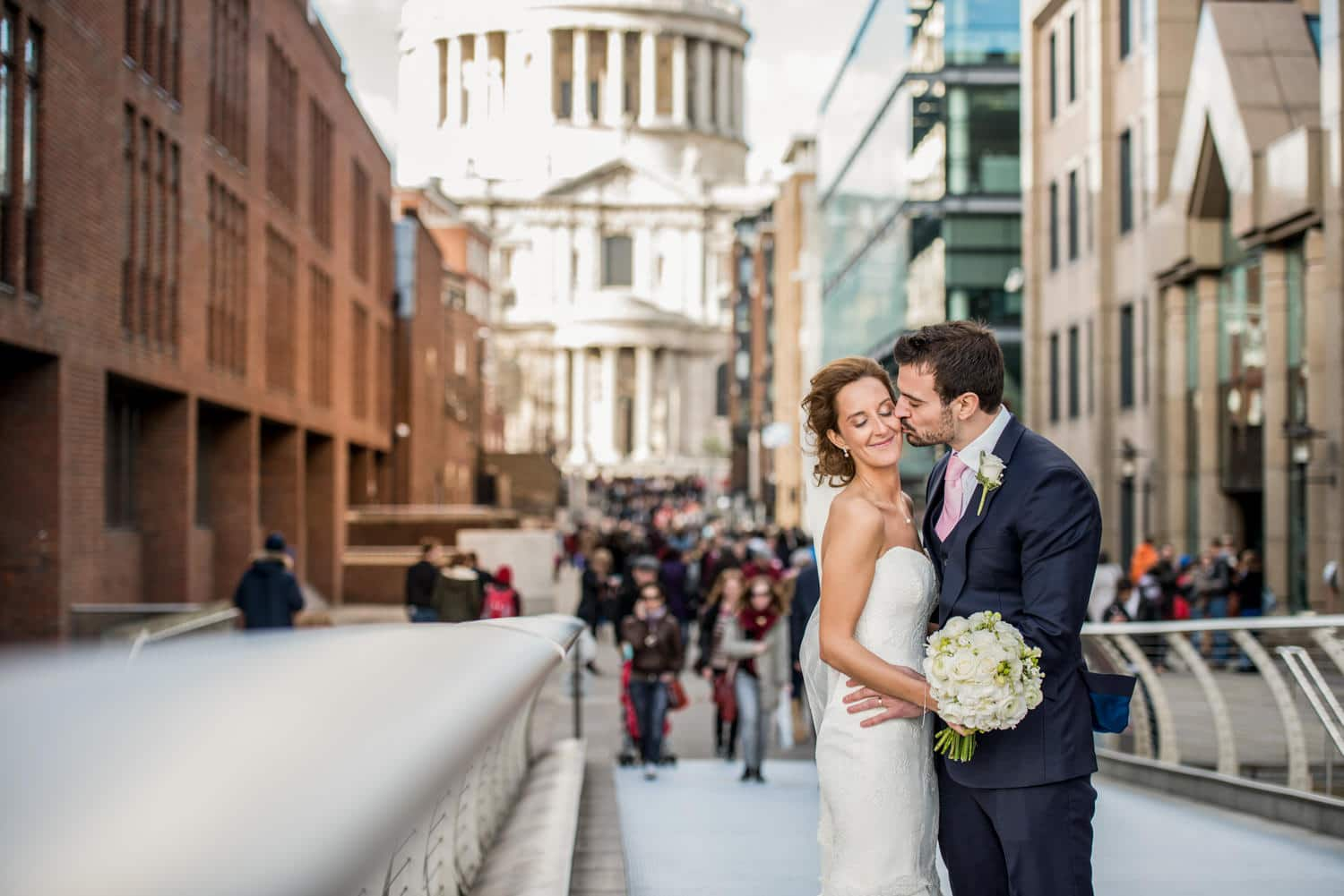 bride and groom portraits in front of St Pauls cathedral