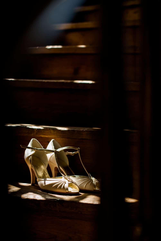 wedding shoes on steps of Chateau de Lacoste wedding venue