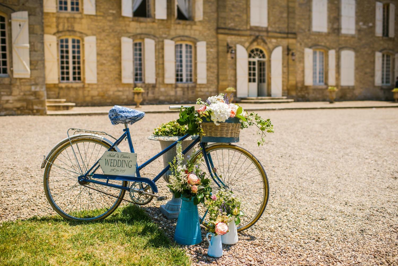 Bike with flowers outside Chateau de Lacoste wedding venue