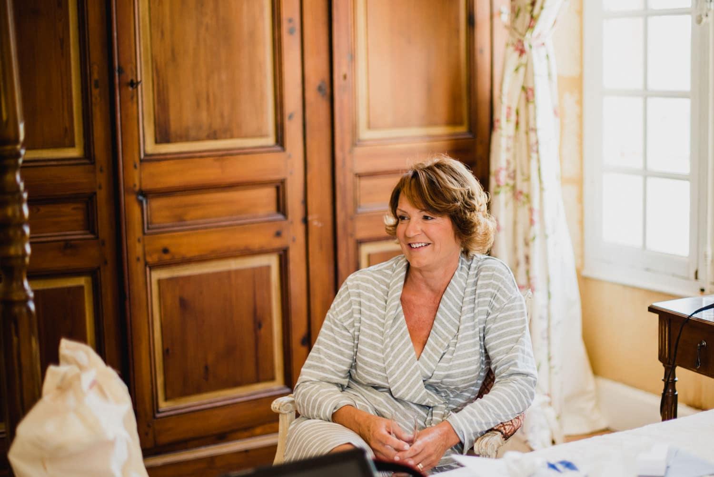 mother of bride in bridal suite of Chateau de Lacoste wedding venue