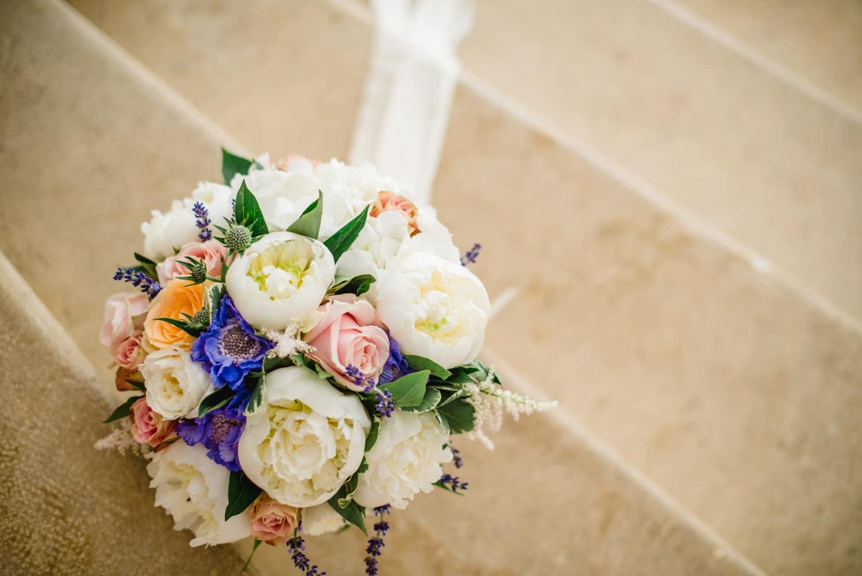 wedding bouquet on steps of Chateau de Lacoste wedding venue