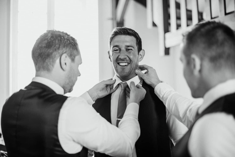 groom getting ready in barn at Chateau de Lacoste wedding venue