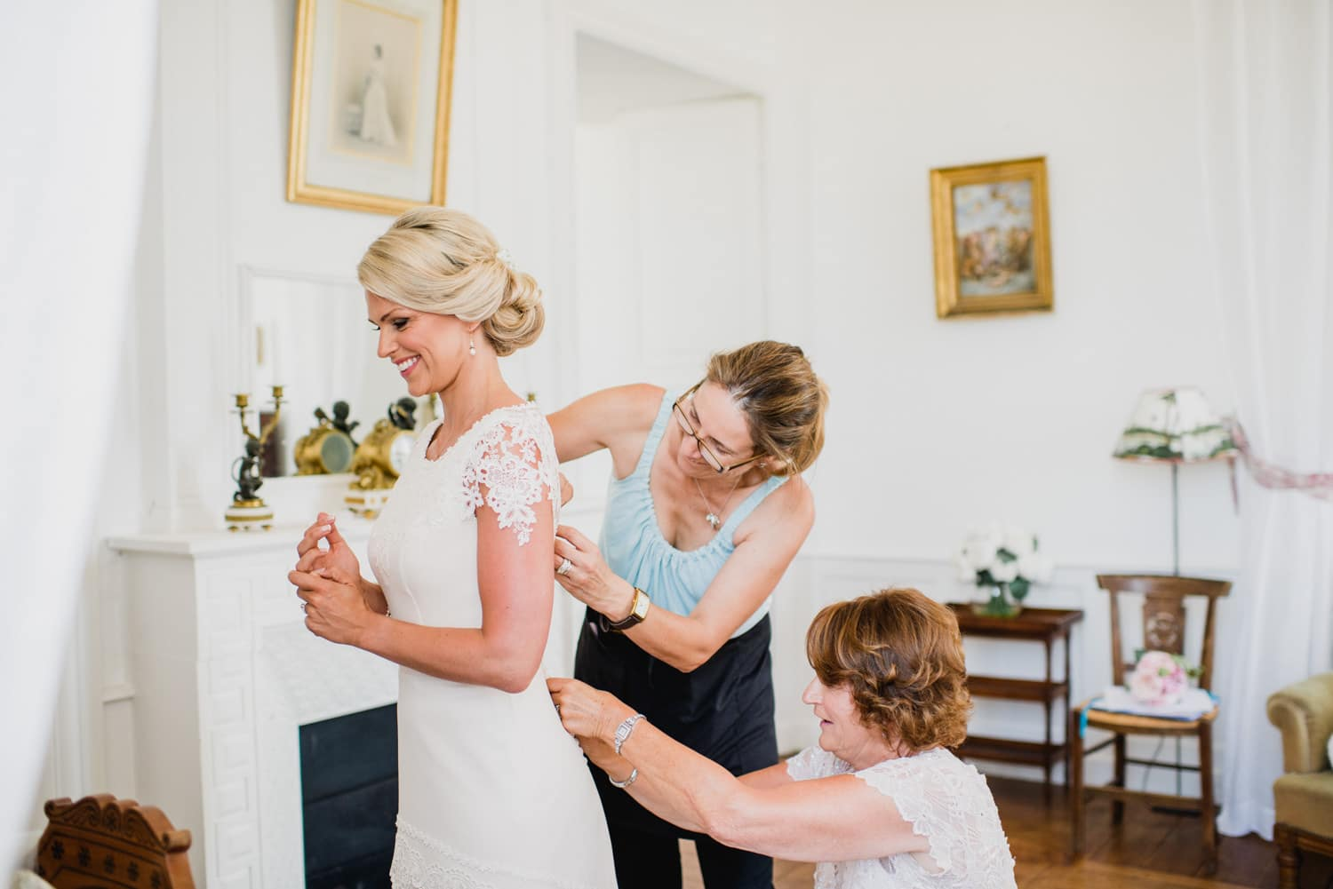 bride getting into her dress at Chateau de Lacoste wedding
