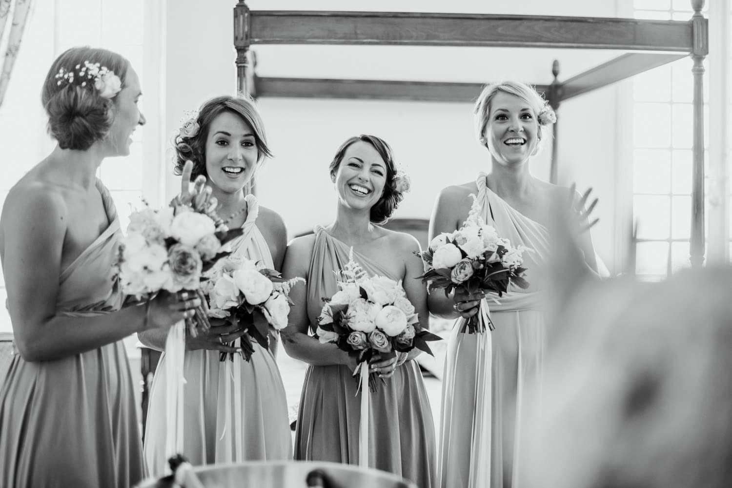 bridesmaids seeing bride for the first time in her dress