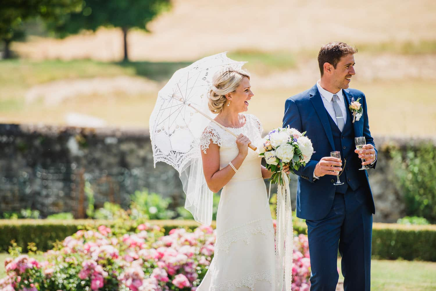bride with white parasol in France