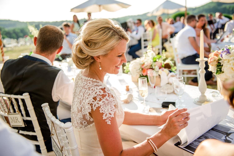 bride during wedding breakfast at Chateau de Lacoste wedding venue