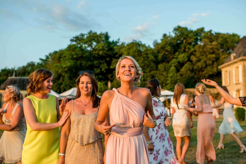ladies waiting to catch wedding bouquet at Chateau de Lacoste