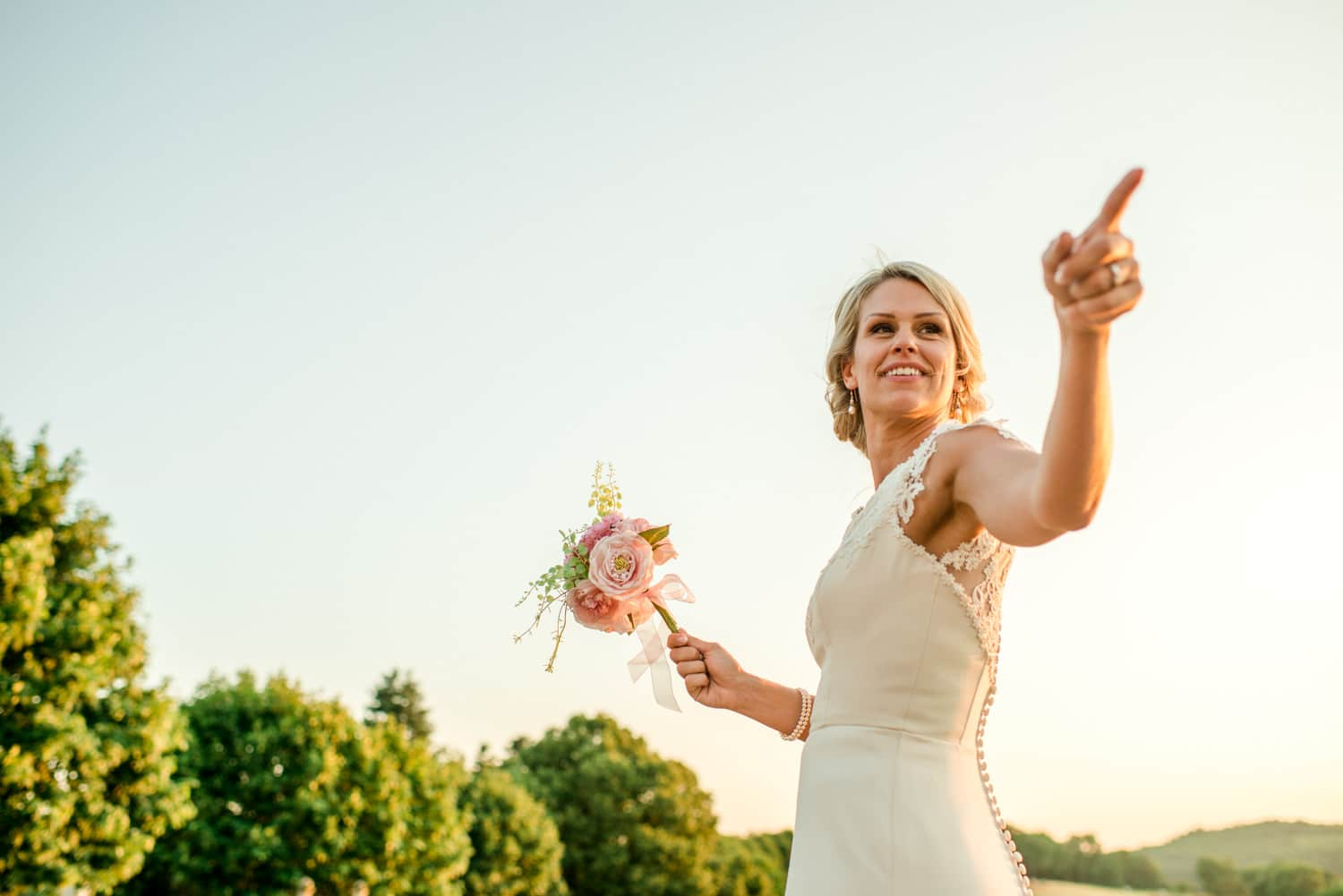bride about to throw wedding bouquet