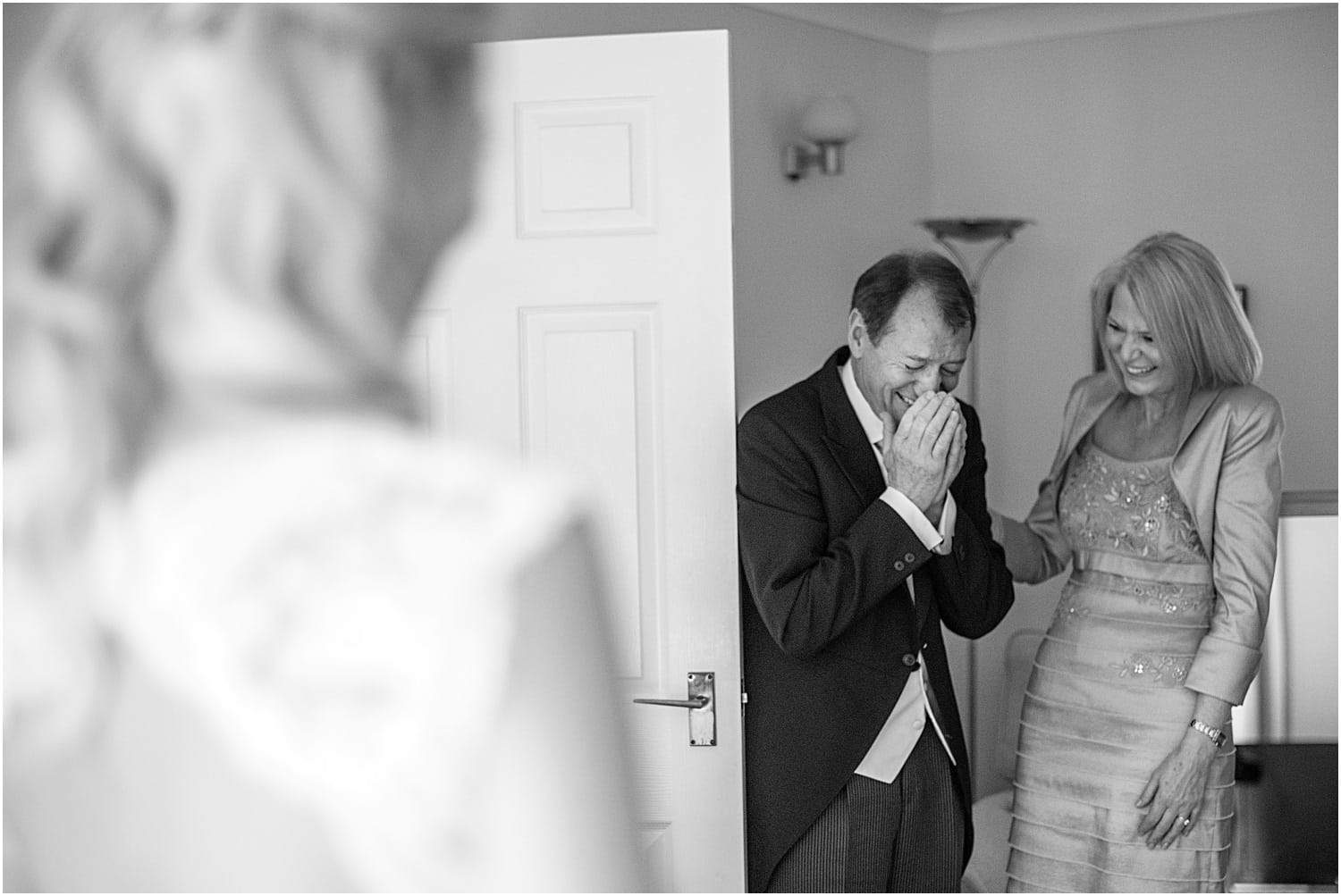 wedding photo of father seeing bride for the first time