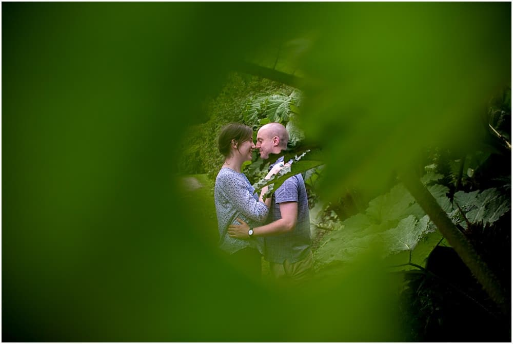 Couple framed by hole in leaf