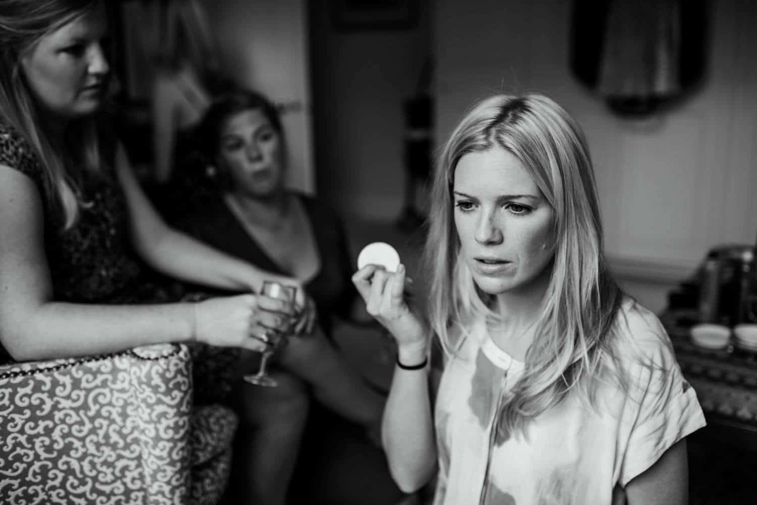 bride concentrating applying her make up