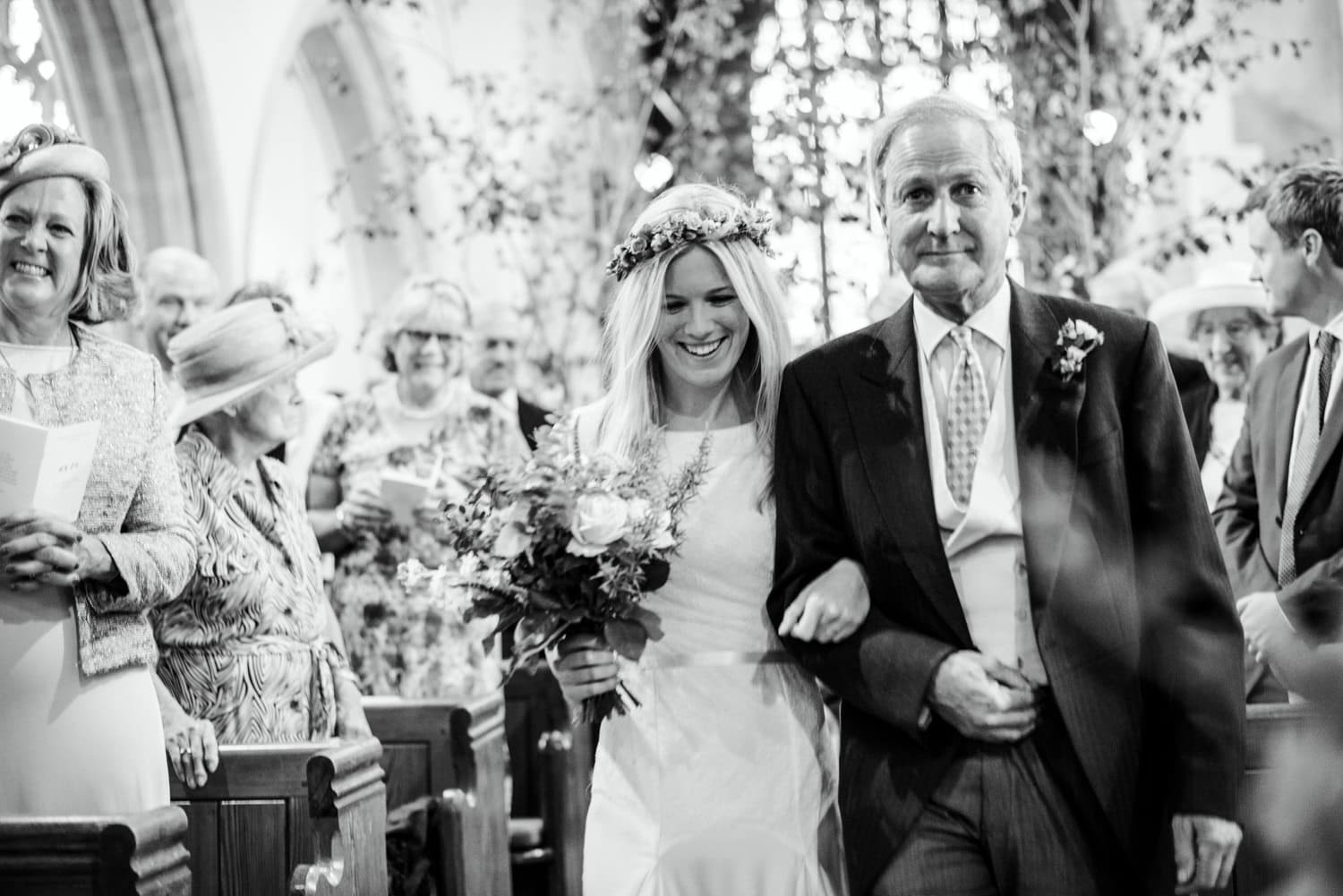 bride with her father walking down the aisle