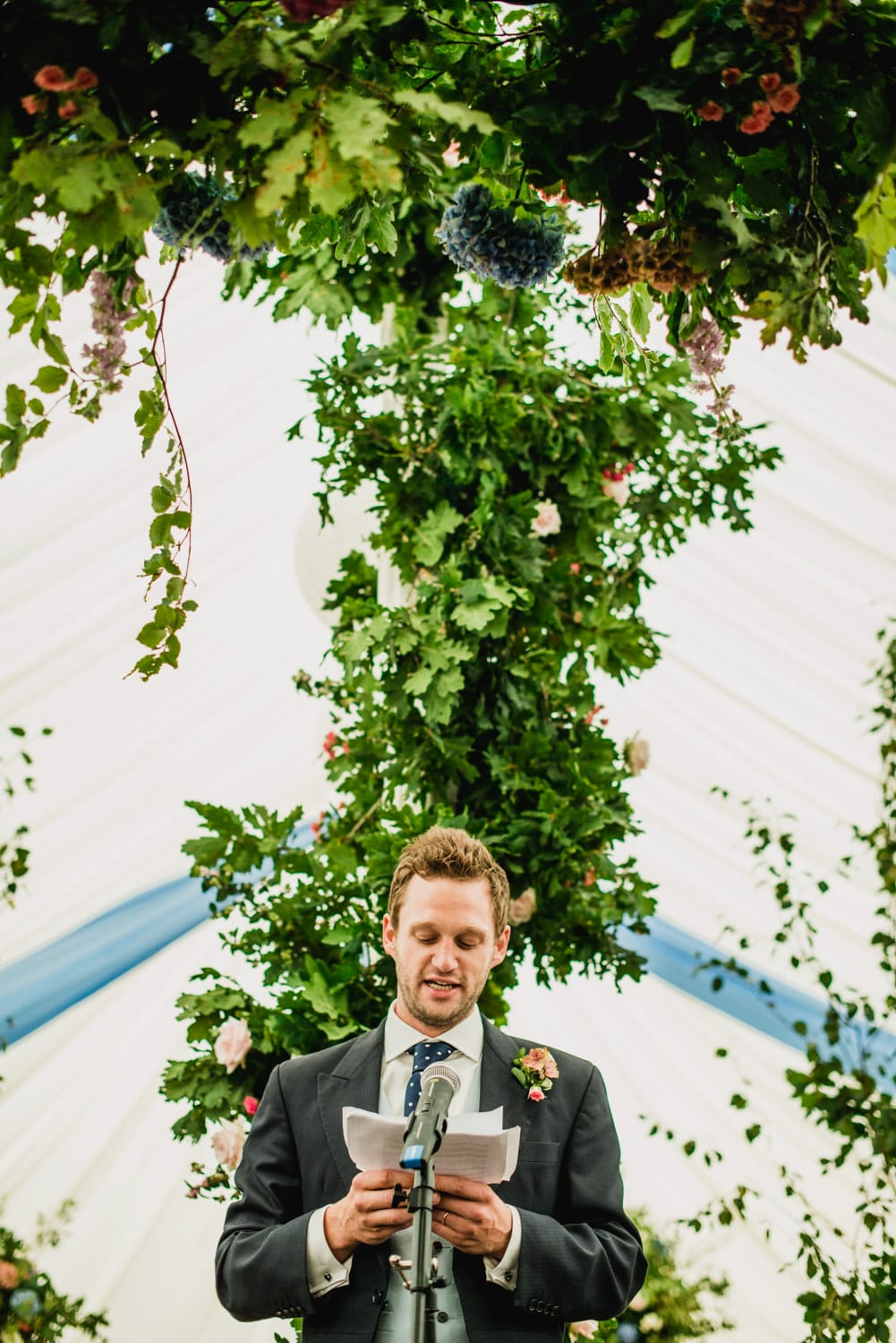grooms speech in wedding marquee