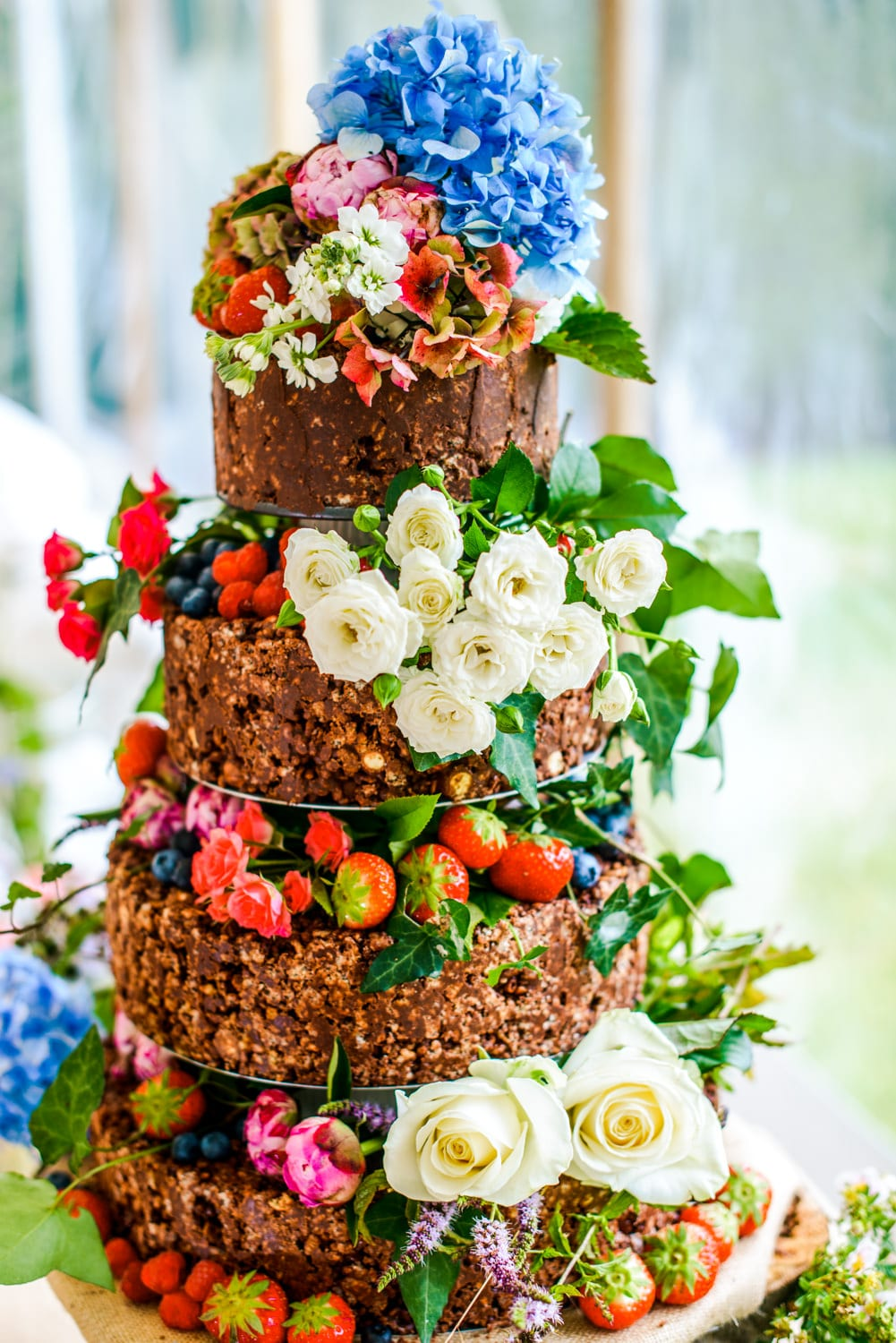 chocolate rice crispy wedding cake with flowers and fruit