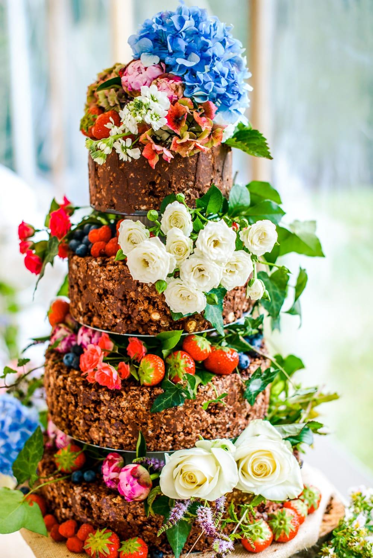 chocolate rice crispy wedding cake with flowers and fruit