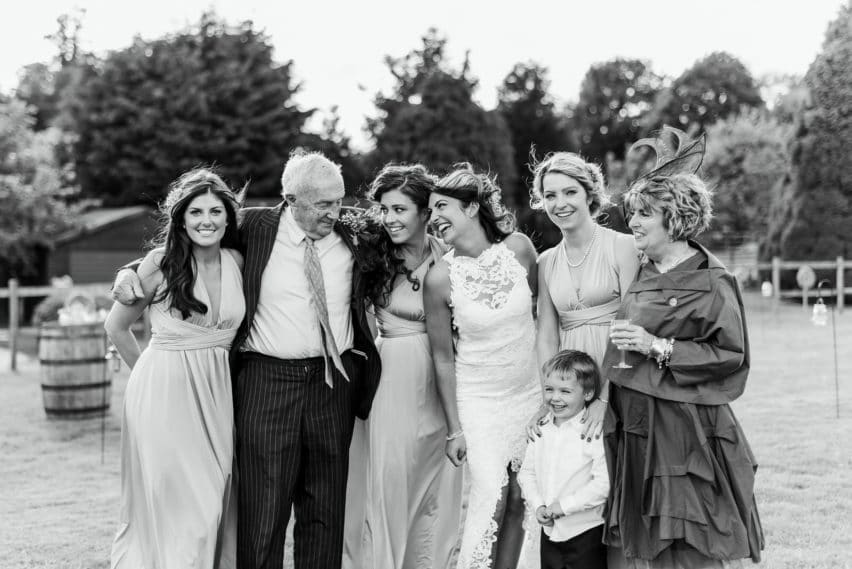 family portrait at wedding, grandfather and his daughter with 4 grandchildren