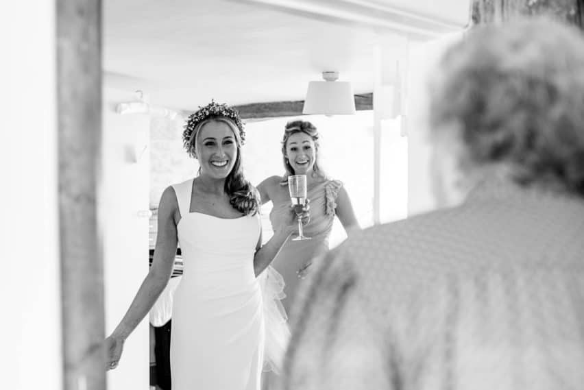 grandmother seeing granddaughter in her wedding dress for the first time