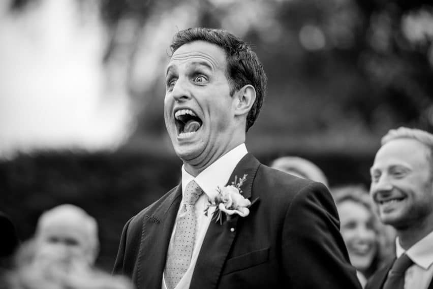 comical facial expression from groom