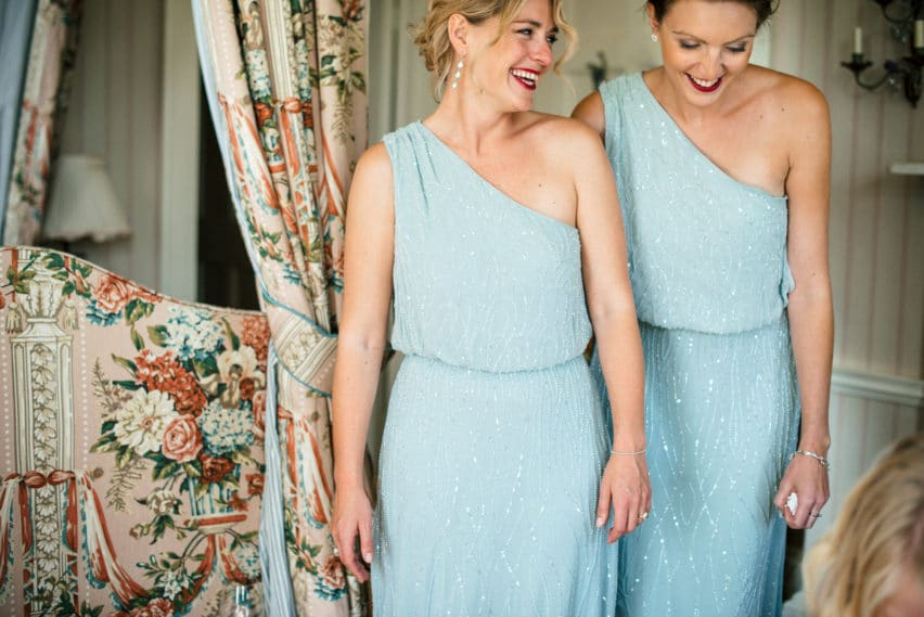 bridesmaids in baby blue one strap dresses