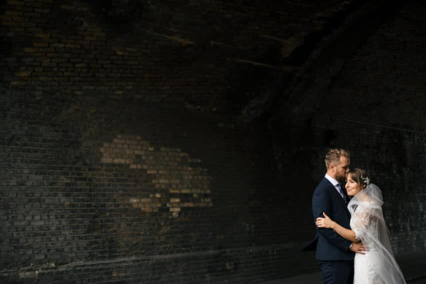 bride and groom portrait in railway arch