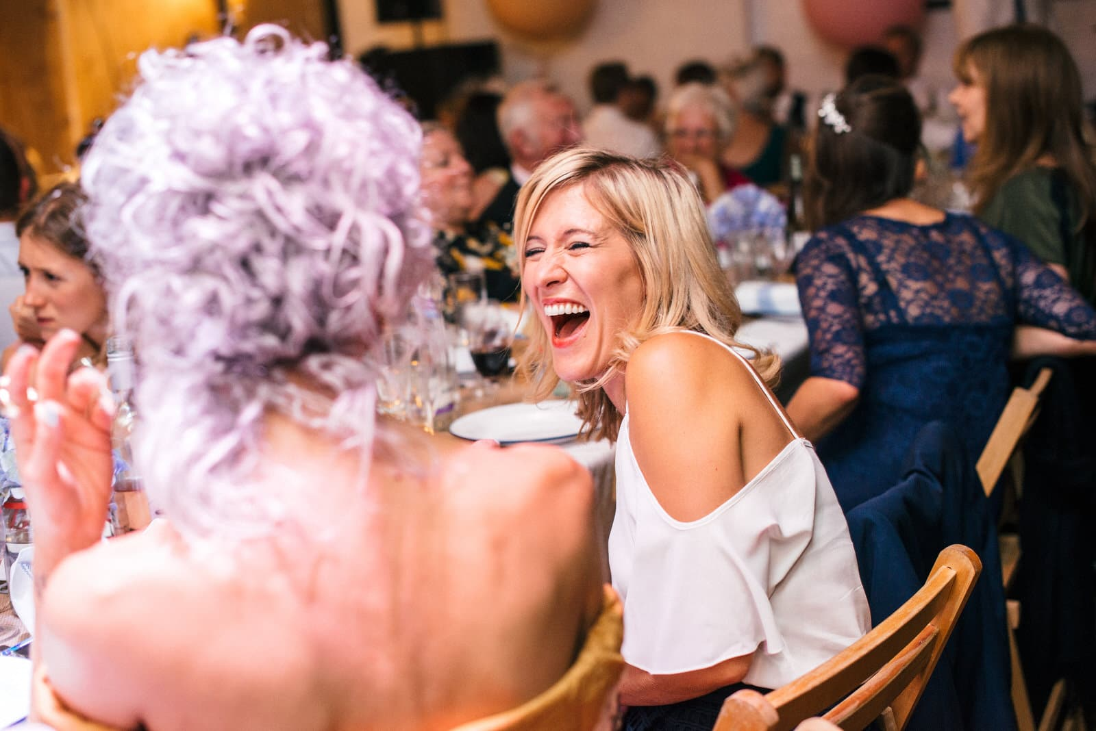 wedding guest laughing