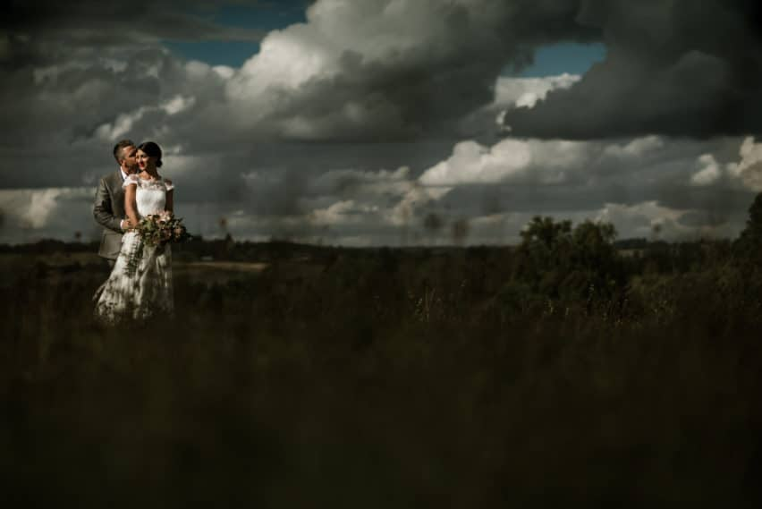 dramatic skies for wedding couple shoot