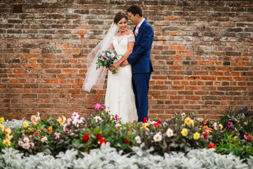 wedding portraits in flower bed