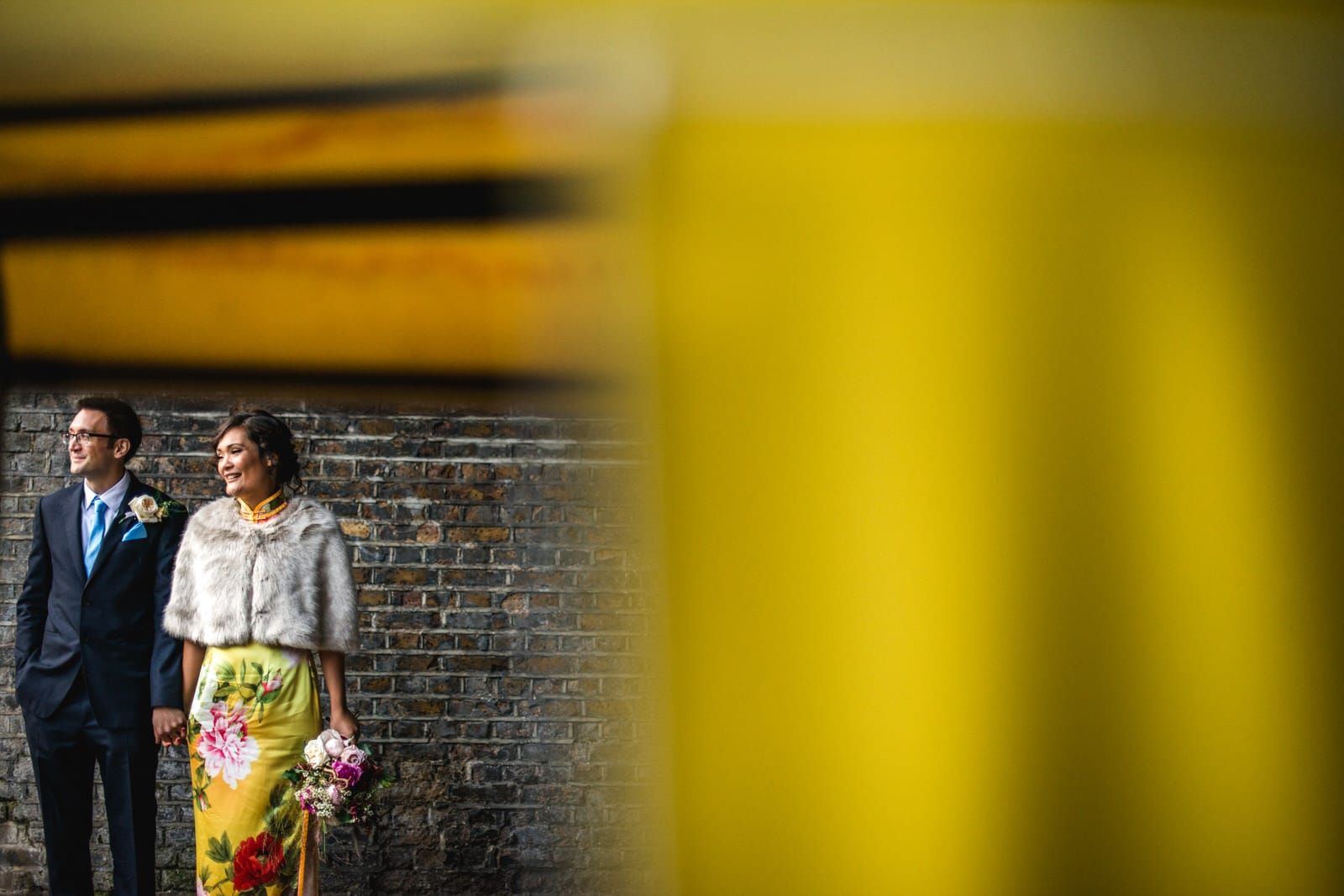 bride and groom through yellow tuk tuk