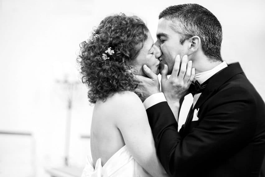 bride and groom first kiss, tear falling down cheek