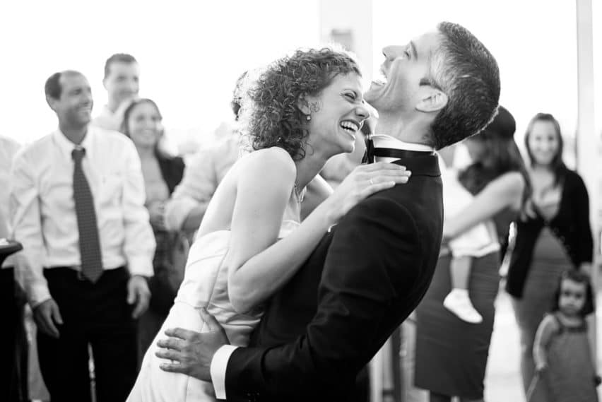 bride and groom laughing on dancefloor