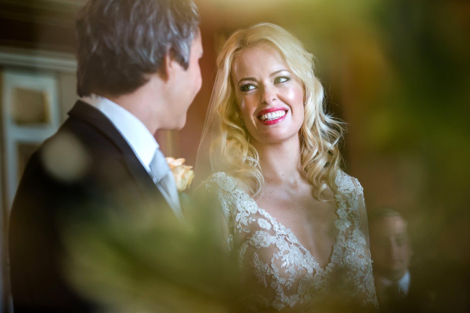 wedding ceremony bride looking happy and in love