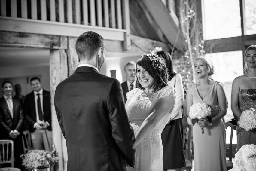 happy bride during wedding ceremony at Bury Court Barn