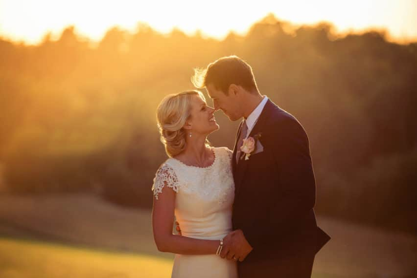 sunset portrait of bride and groom