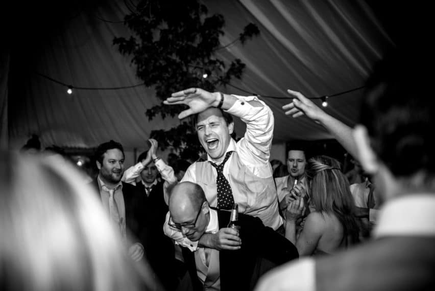 guest dancing at wedding