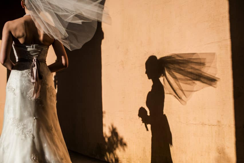 brides shadow on terracotta wall