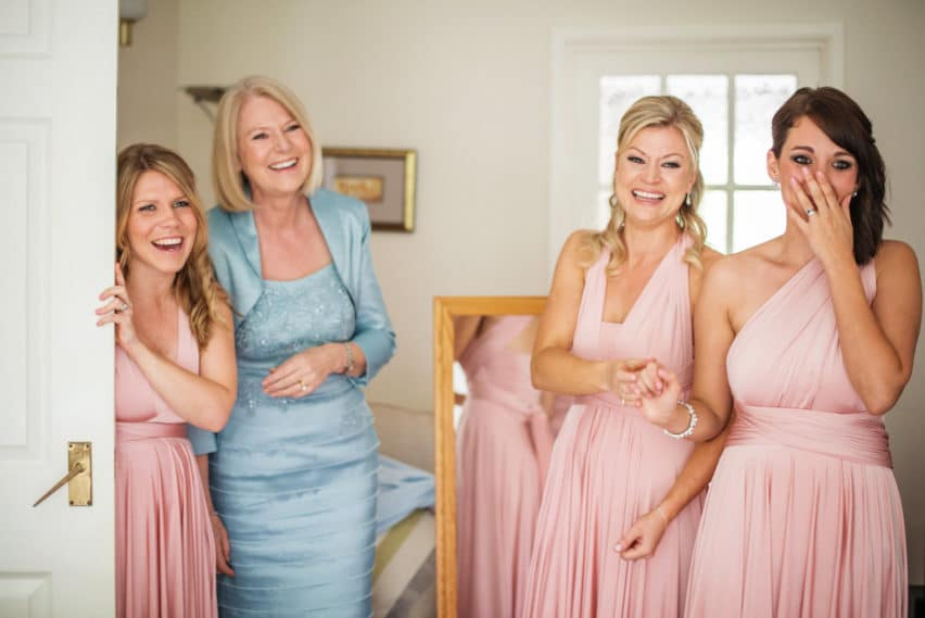 bridesmaids and mother of brides first reaction to seeing bride in dress