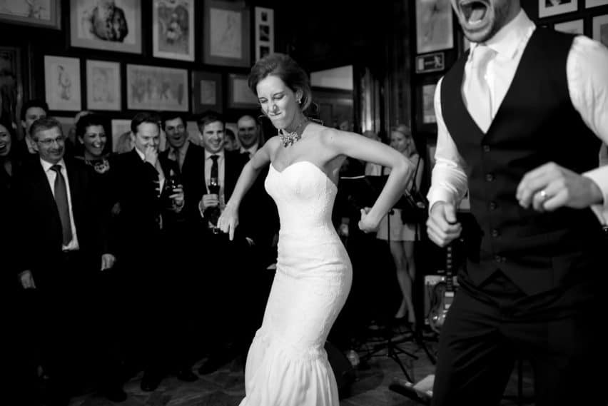 bride and groom performing comical dance at wedding