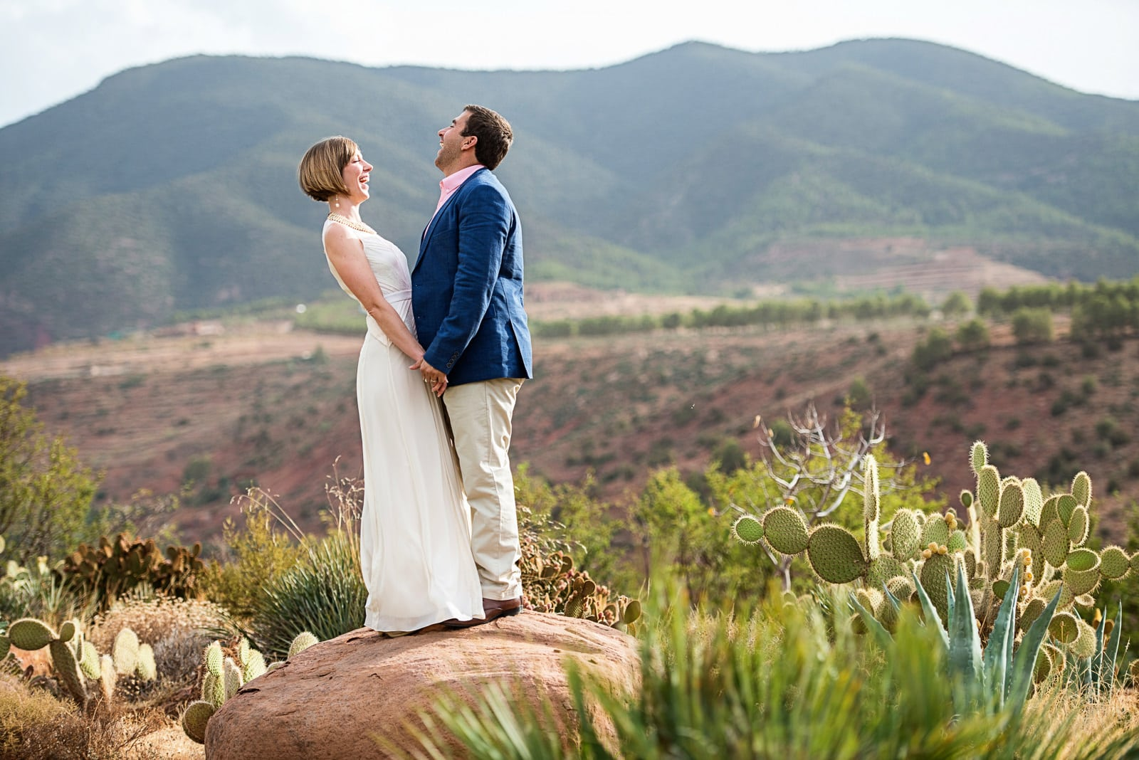 couple standing on rock in Atlas mountains