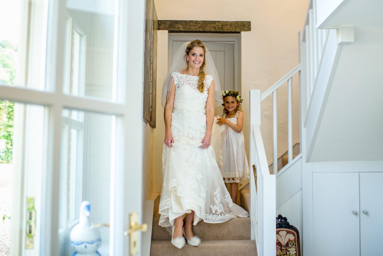 bride walking dowan stairs