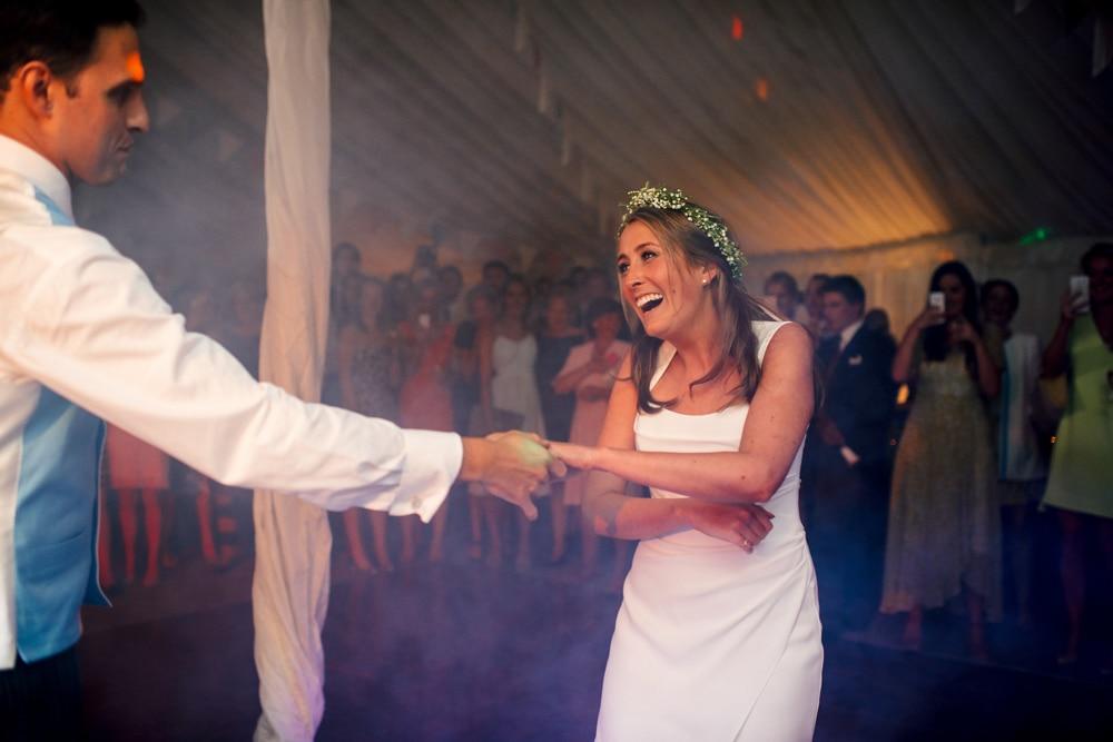 Bride on dancefloor in marquee