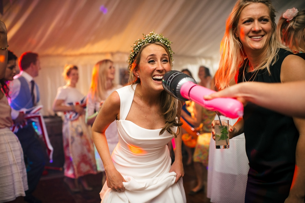 bride singing into inflatable microphone